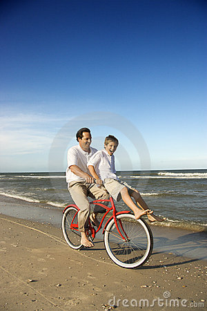 Dad and son riding bicycle