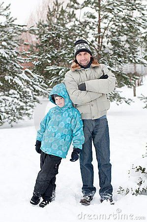 Dad and son walking in  winter park