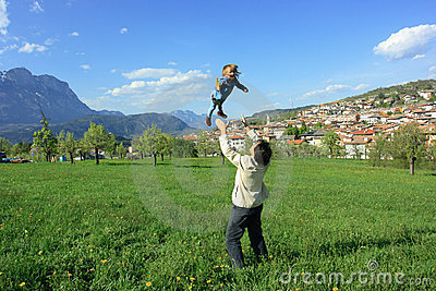 Dad throwing daughter in air