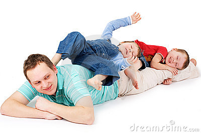 Dad and two sons posing in studio