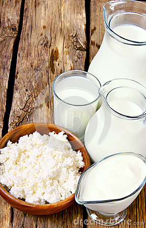 Dairy products on wooden background.