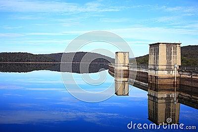 Lake reflecting dam landscape