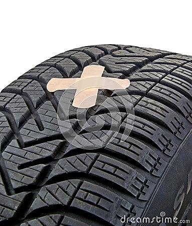 A damaged car tyre