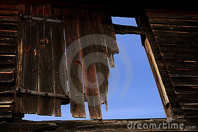 Damaged Old Barn Wood Door over Blue Sky