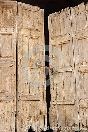 Old wooden door in ancient historical greek house.
