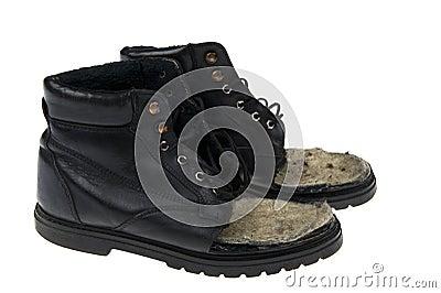 Damaged old shoes on white