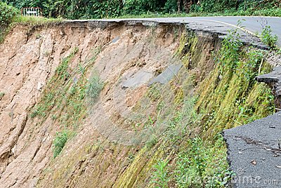 Damaged road from landslide on mountain