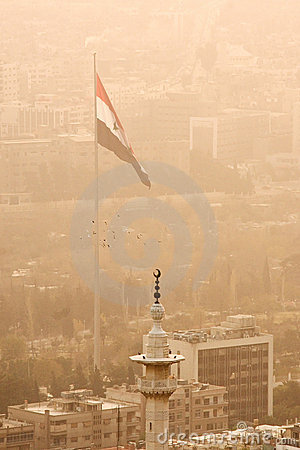 Damascus, capital of Syria with Syrian flag.