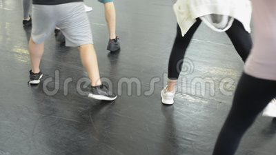 Dance class at a studio. Detail of a dance class showing shoes and people dancing in sync stock video