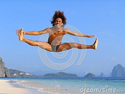 Dance jump on tropical beach