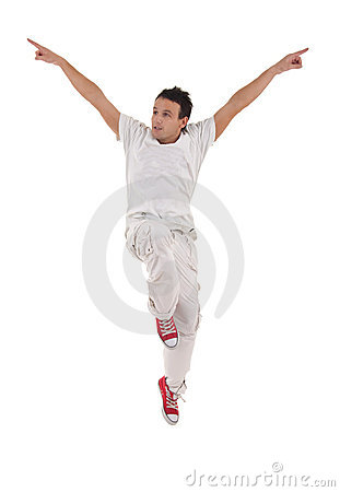 Dancer with hands up jumps