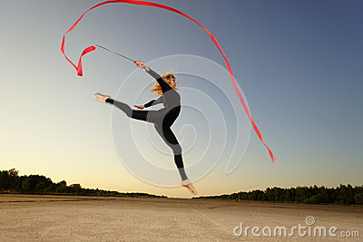 Dancer jumping with ribbon