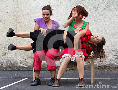 Dancer on the knees of two women Editorial Image