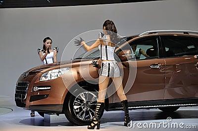 Dancer posing near car at Chengdu Motor Show 2012 Editorial Stock Image
