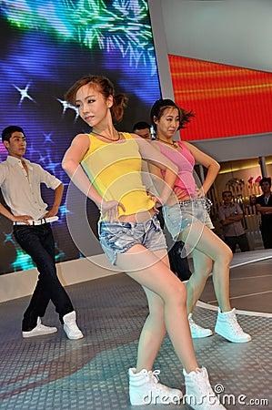 Dancer posing near car at Chengdu Motor Show 2012 Editorial Stock Photo