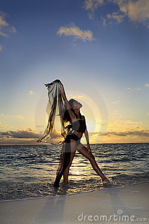 Dancer standing at the ocean edge