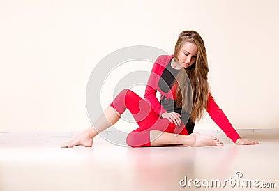 Dancer woman sit on half twine