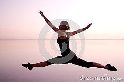 Dancers jump split