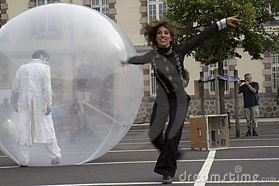 Dancers with a transparent sphere Editorial Stock Image