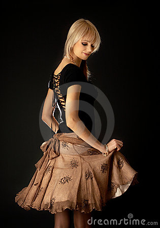 Free Dancing Blond In Brown Skirt Royalty Free Stock Images - 2462139