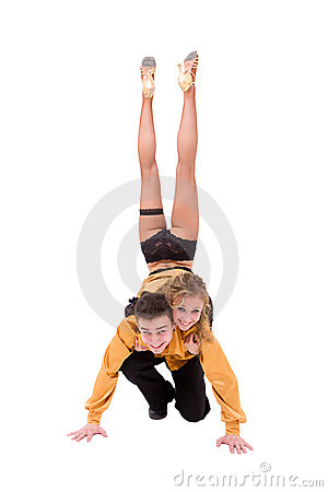 Dancing couple posing against isolated white