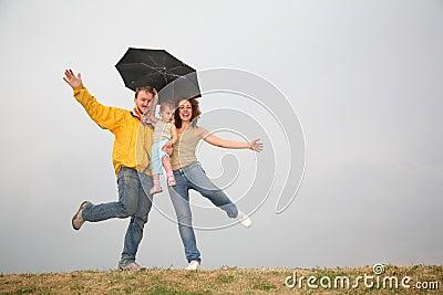 Dancing family under umbrella
