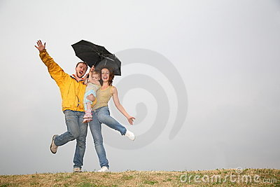 Dancing family under umbrella