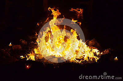 Dancing fire at night in stone ring