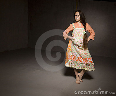 Dancing girl in ethnic dress
