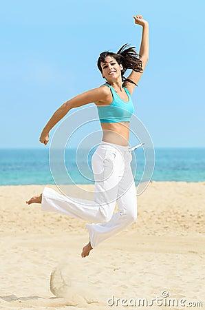 Dancing happy girl jumping fun