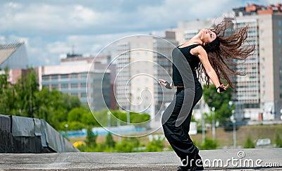 Dancing hip-hop over urban city