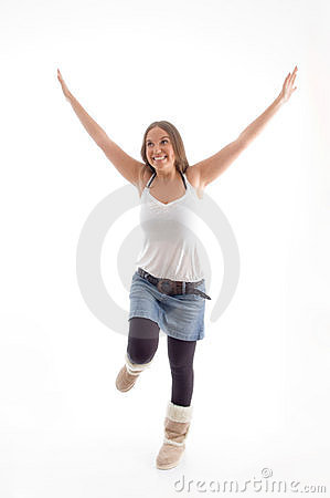 Dancing model with raised arms