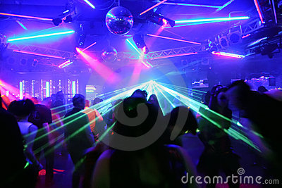 Dancing people in front of flashing laser beams