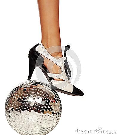 Dancing shoe and leg on disco ball