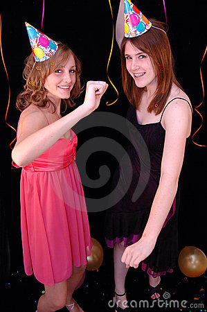 Dancing teens in party hats