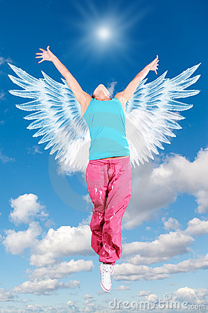 Dancing woman angel with wings in sportswear jumps