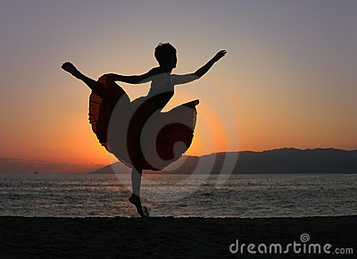 Dancing woman on the beach