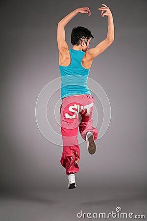 Dancing woman in sportswear  jumps from back