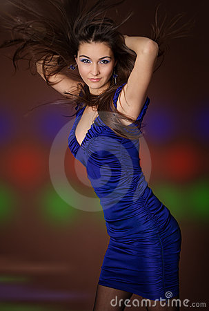 Dancing young sexy woman with flying hair