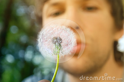 Dandelion and man face on background