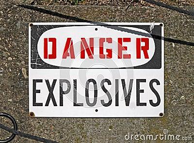 Danger explosives, warning message on signboard,
