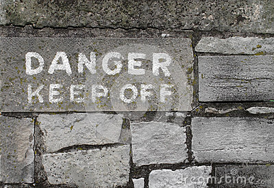 Danger keep off sign on stone
