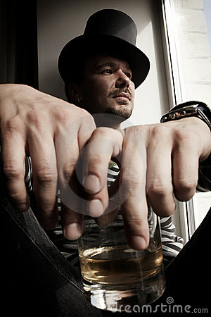 Free Danger Man In Top Hat With Glass Of Whiskey Royalty Free Stock Photo - 6744925