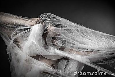 Danger.man tangled in huge white spider web