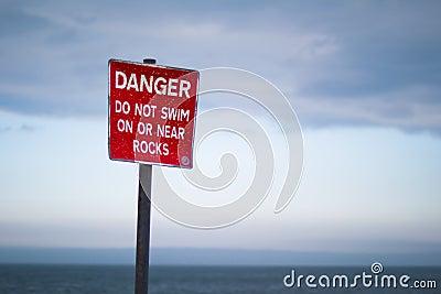 Danger sign on beach