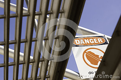Danger sign viewed from under stairs