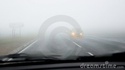 Dangerous driving on road in fog