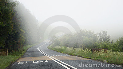 Dangerous driving on road in fog: slow mark
