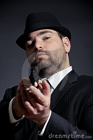 Dangerous man pointing a gun