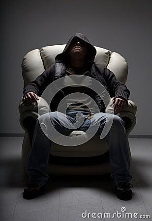 Free Dangerous Man Sitting In White Stock Photos - 2451203